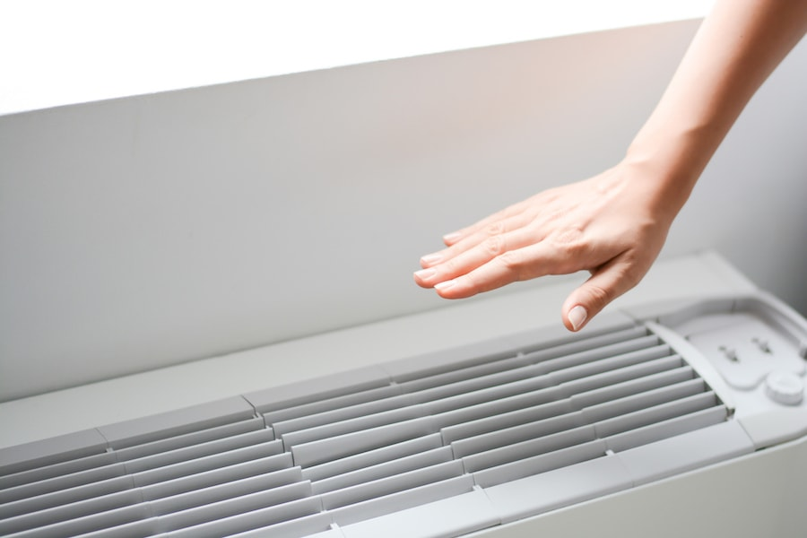 hand-over-AC-unit